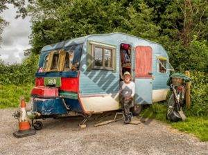 rv camper with old man sat on the step