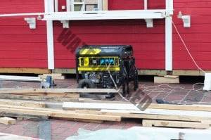 portable generator connected and running power on a home building site