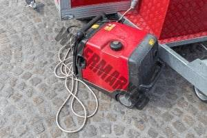 small portable quiet generator on ground connected up