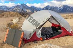 solar generator with solar panels collecting power while out camping