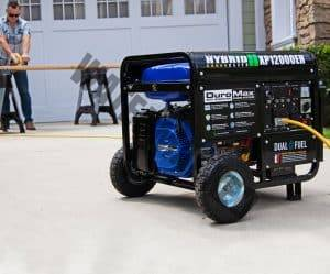 backup generator sitting on driveway with workman in background