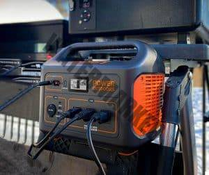 portable generator resting on rear of truck bed powering electrical devices
