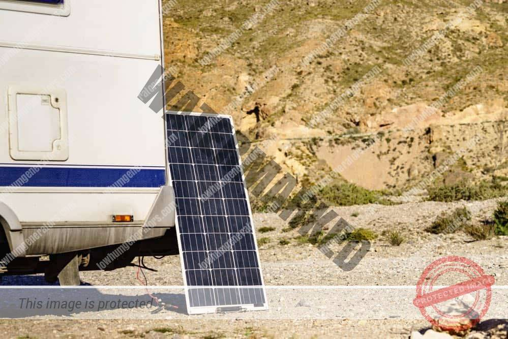 portable solar photovoltaic panel, charging battery at camper car rv.