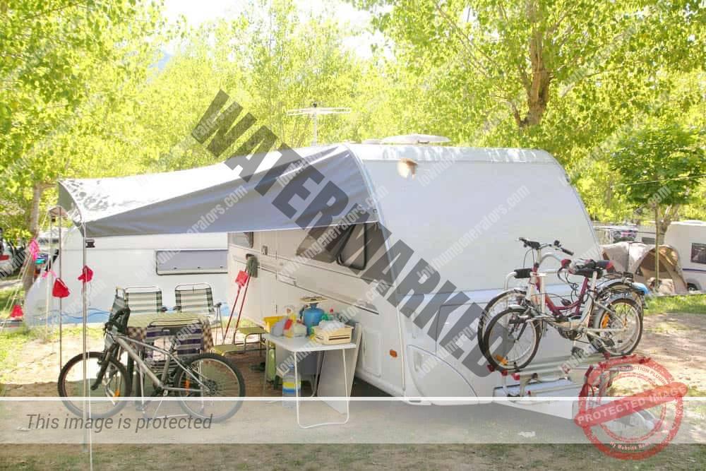family rv camping caravan setup with quiet generator
