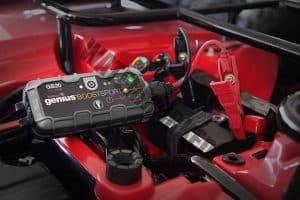 lithium boost jump pack on a car battery