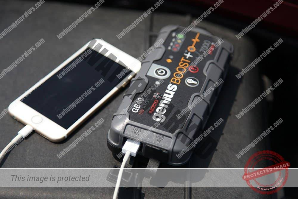 noco genius gb40 boost pack being used as a usb power source for a mobile phone charge